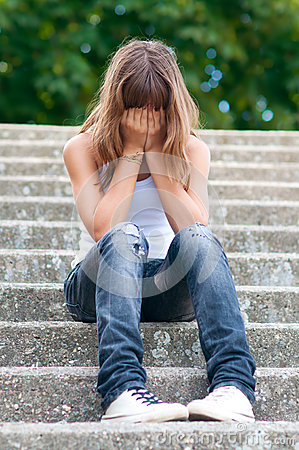 Free Sad Teenage Girl Sitting Alone On The Stairs Royalty Free Stock Photo - 25911885