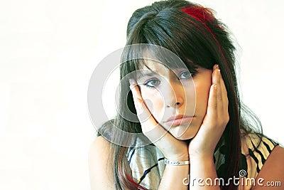 Sad teenage girl on white