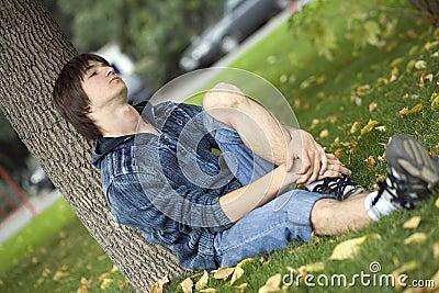 Sad teenager in park