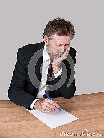 Sad, tired man at desk
