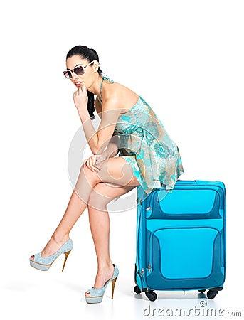 Free Sad Tourist Woman Seated Next To A Suitcase Stock Photo - 28773990