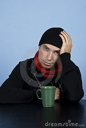 Free Sad Winter Man At Table Royalty Free Stock Images - 12008189