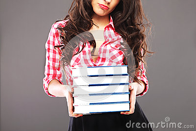 Sad woman with books
