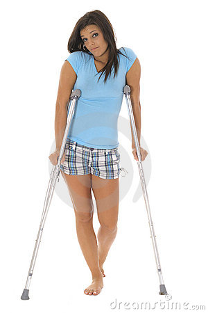 Sad woman on crutches