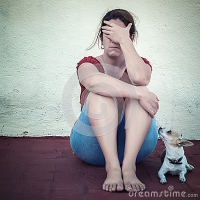 Free Sad Woman Crying With A Small Dog Besides Her Royalty Free Stock Photo - 37760195
