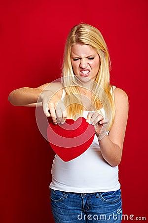Sad woman with a heart