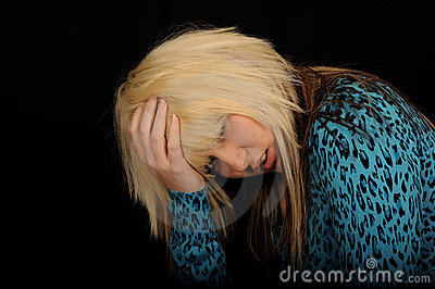 Sad woman holding head