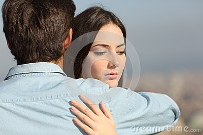 Sad Woman Hugging Her Boyfriend Couple Problems Stock ...