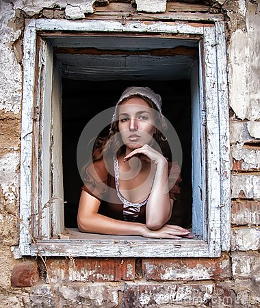 Free Sad Woman In A Rustic Dress Sitting Near Window In Old House Feel Lonely. Cinderella Style Stock Photography - 102212252