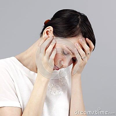 Sad woman isolated on grey background