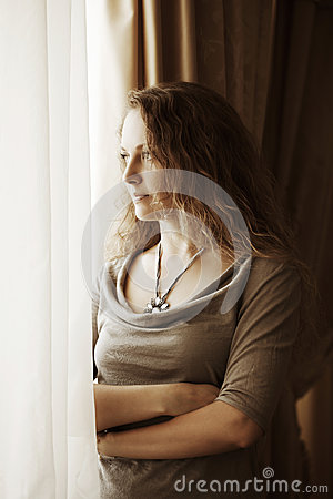 Free Sad Woman Looking Out The Window Stock Images - 26227774