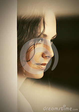 Free Sad Woman Looking Out Window Stock Photography - 82213612