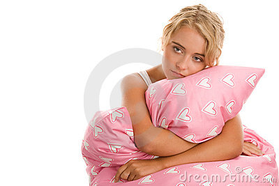 Sad woman with pink pillow