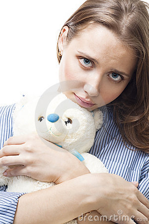 Sad woman with teddy bear