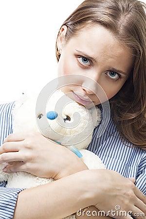 Sad woman with teddy bear
