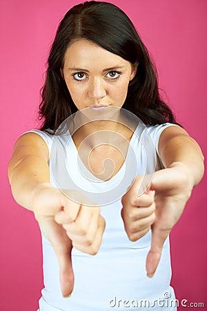 Sad woman with thumb down