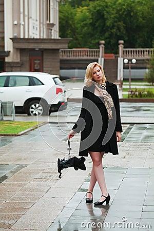 Sad woman with umbrella