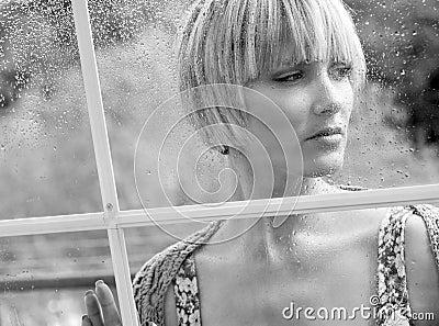 Sad woman at the window