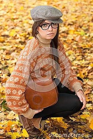 Sad young girl with handbag