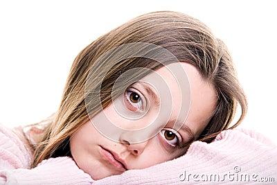Sad young girl isolated