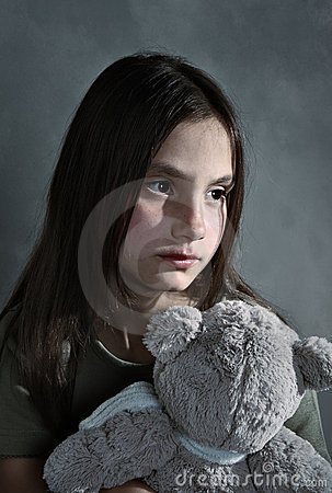 Sad young girl with toy