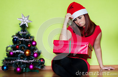 Sad young woman in Christmas time