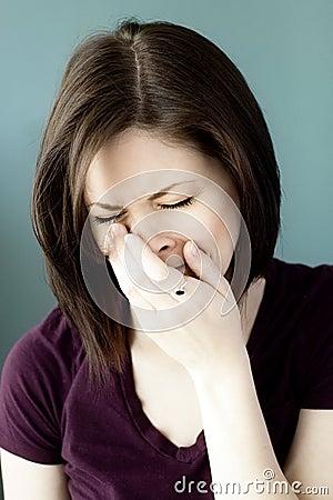 Sad young woman crying