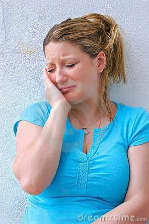 Sad young woman crying alone.