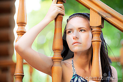 Sad young woman at handrail