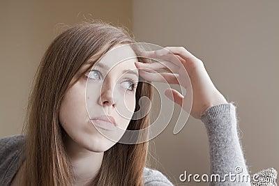 Sad young woman at home