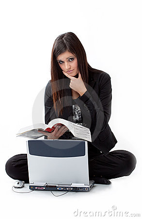 Sad young woman seeking for help by computer