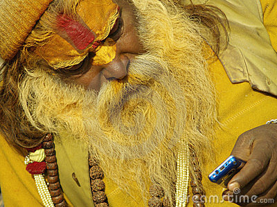 Sadhu with mobile phone in Shivaratri Editorial Photography