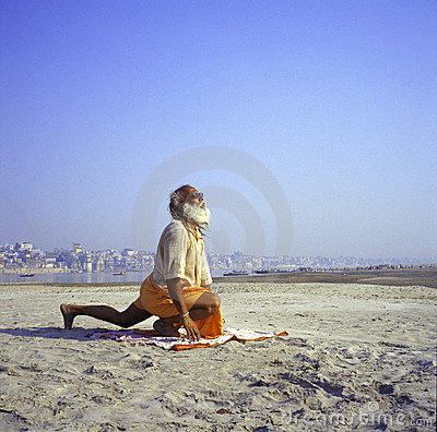 Varanasi, India, Sadhu performing yoga Editorial Stock Photo
