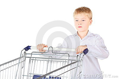 Sadness boy is standing near shopping basket