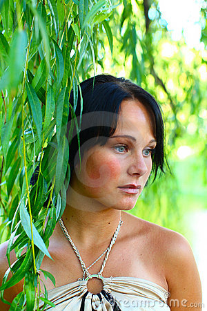 Sadness girl and weeping willow