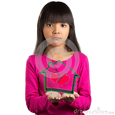 Sadness little asian girl holding virtual house with broken hear