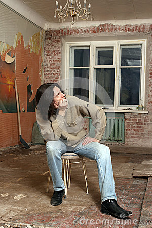 The sadness man sit on chair