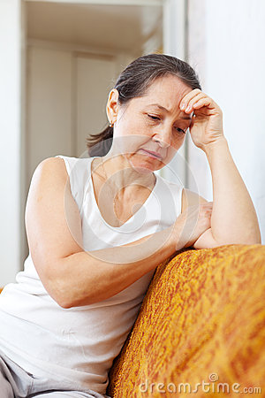 Sadness mature woman