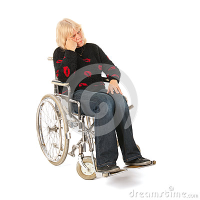 Sadness woman of mature age in wheel chair