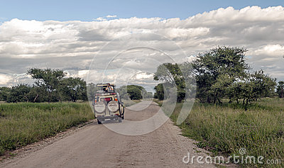 Safari car on the roads in Tanzania Editorial Stock Image