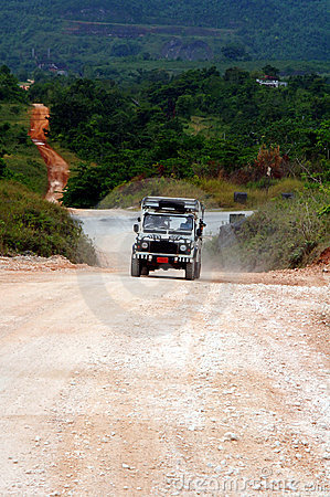 Safari jeep on dirt road