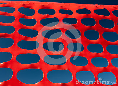Safety barrier lattice pattern orange and blue sky