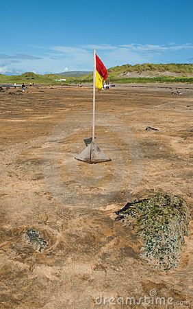 Safety beach swim flag on a sandy beach ireland