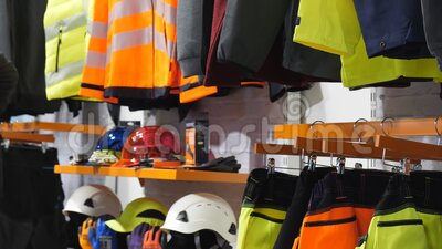 Safety clothing display pan. Safety workwear and personal protective equipment display in the industrial clothing shop stock video footage