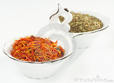 Saffron and green spice in porcelain dish
