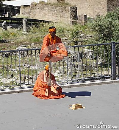 Free Saffron Robe Clad Street Performers Royalty Free Stock Photo - 38874745