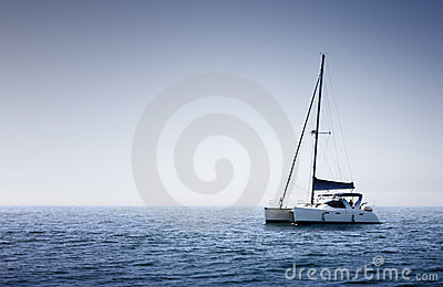 Sail Boat on the blue ocean