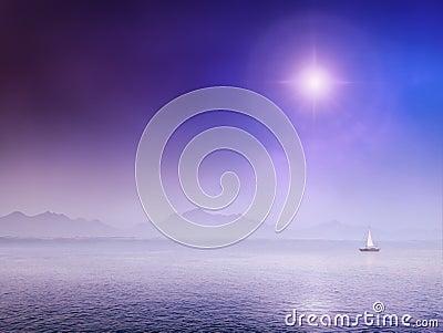 Sail Boat on misty ocean
