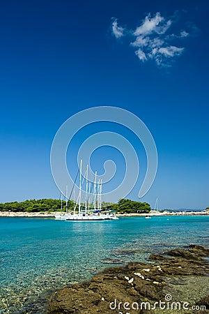 Sail boats docked in beautiful bay, Adriatic sea,