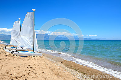 Sail yachts on the beach on Ionian Sea at luxury hotel